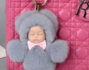 Меховой брелок на сумку Куколка фото