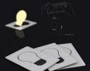 Карманный светильник складывается в форму визитки фото 2